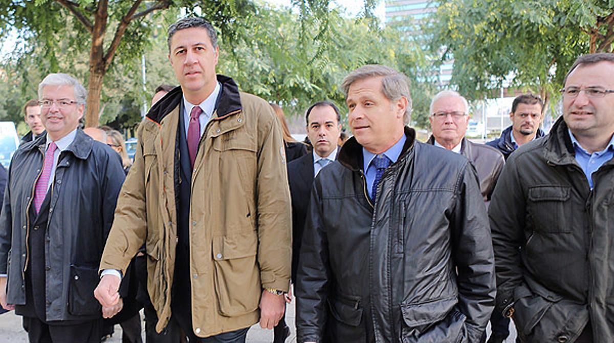 El alcalde de Badalona, Xavier García Albiol, llega a la Ciutat de la Justícia