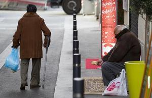 Pobres en el mercado de la Llibertat, este diciembre.