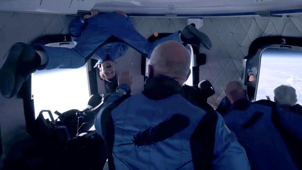 Recent Dutch high school graduate Oliver Daemen and pioneering female aviator Wally Funk float weightlessly