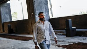 LONDON, ENGLAND - JUNE 08: Designer Khalid bin Sultan Al Qasimi walks the runway at the Qasimi show during London Fashion Week Men's June 2019 on June 08, 2019 in London, England. (Photo by John Phillips/BFC/Getty Images for BFC)