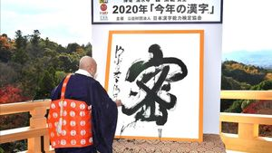 This picture received from Jiji Press shows Seihan Mori  master of the ancient Kiyomizu temple  using calligraphy to write the Chinese character  known in Japan as  kanji   for  mitsu   which was selected as the single best kanji to symbolise the year of 2020 at the temple in Kyoto  western Japan  on December 14  2020  (Photo by STR   JAPAN POOL   AFP)   Japan OUT