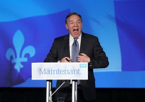 Coalition Avenir Quebec (CAQ) party leader Francois Legault speaks to supporters from the podium in Quebec City, Quebec, Canada October 1, 2018. REUTERS/Chris Wattie