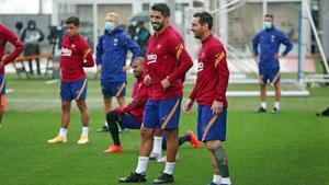 Suárez y Messi, en el entrenamiento de este miércoles en la ciudad deportiva del Barça.