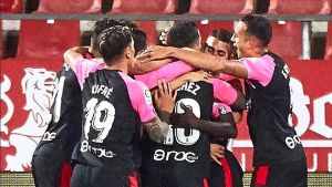 Los jugadores del Mallorca celebran el gol de Salva Sevilla en Montilivi.