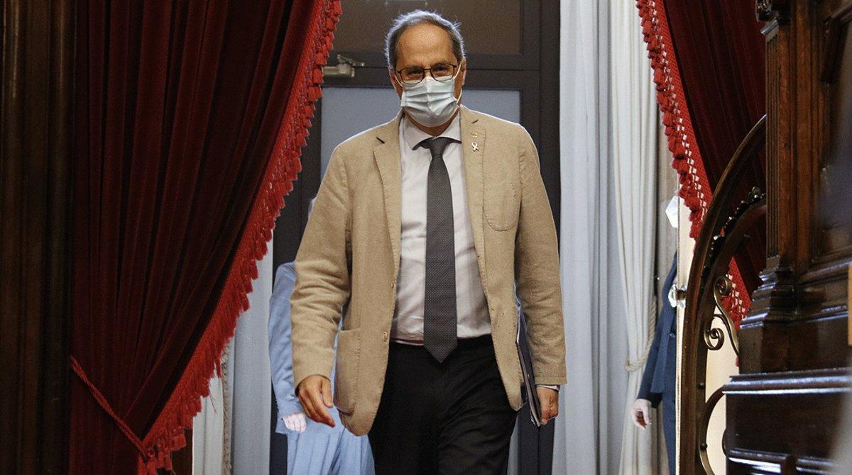 El 'president' Quim Torra entra en el salón de plenos del Parlament, el pasado 8 de julio.