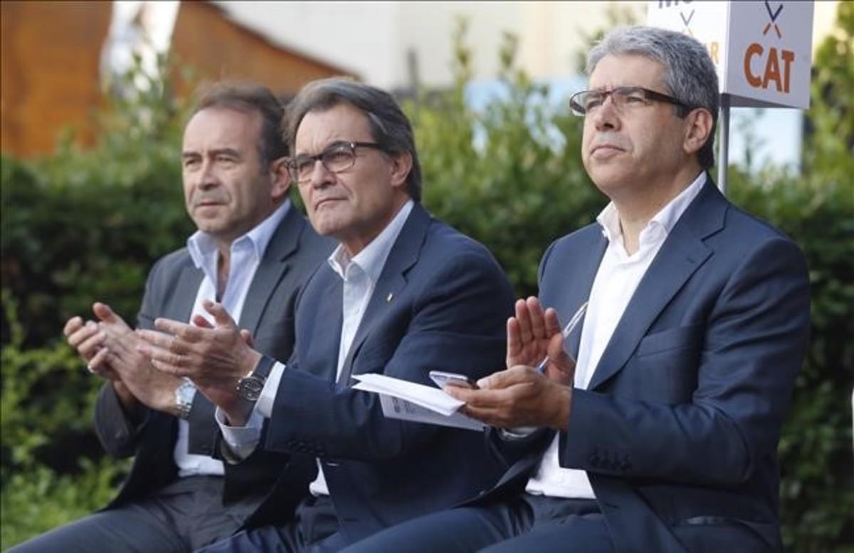 'Mikimoto', Artur Mas y Francesc Homs, en el mitin de CDC en Sabadell.