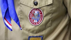 A Boy Scout Eagle badge is seen in this file photo taken in Orlando, Florida May 30, 2012.  The Boy Scouts of America could face a wave of bad publicity as decades of records of confirmed or alleged child molesters within the U.S. organization are expected to be released in coming weeks.  REUTERS/David Manning/Files  (UNITED STATES - Tags: SOCIETY)