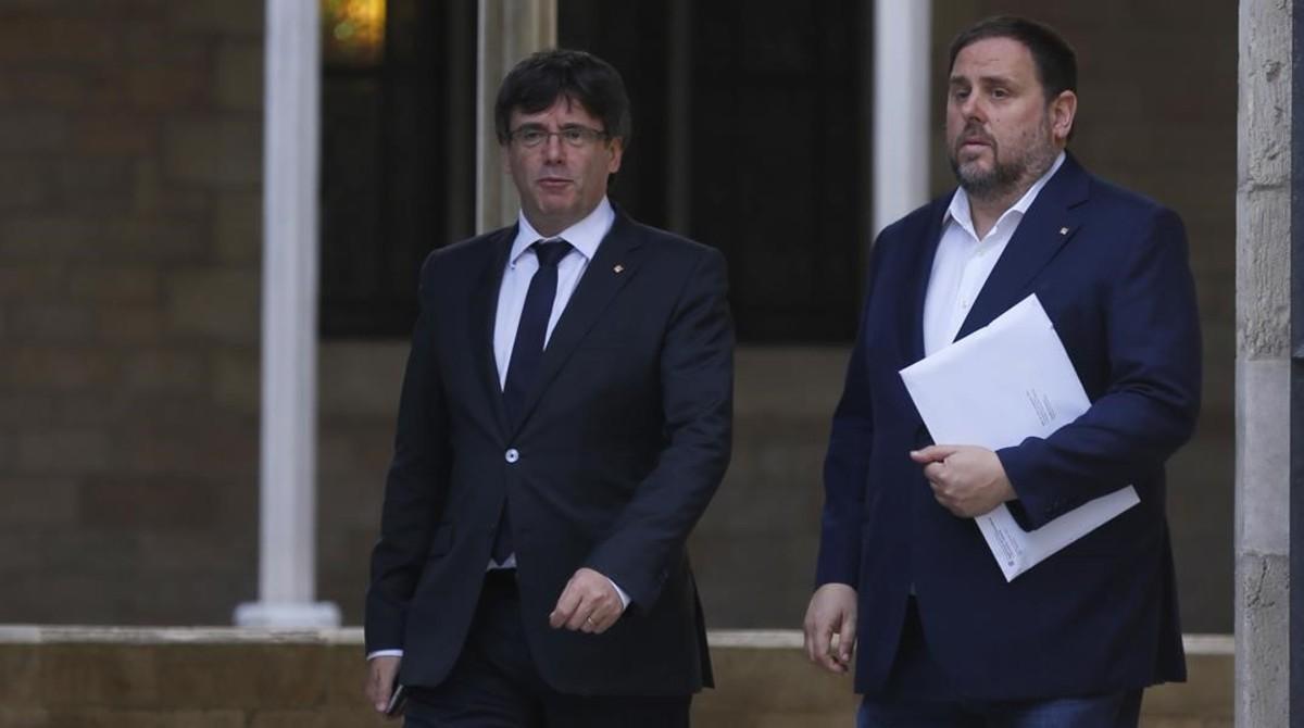 El 'president', Carles Puigdemont, y el vicepresidente del Govern, Oriol Junqueras.