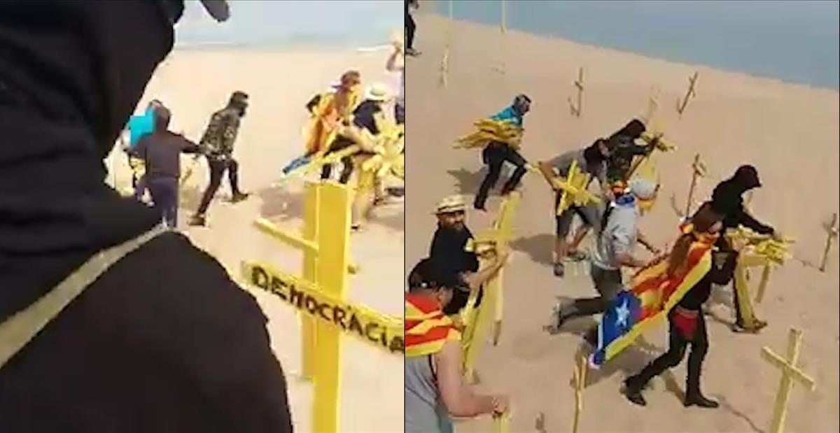 Enfrentamientos porlas cruces amarillas en la playa de Canet de Mar.