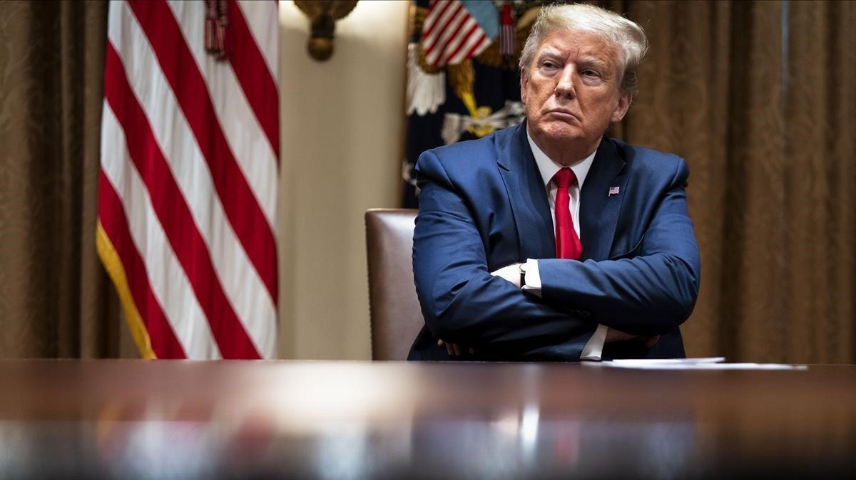 El presidente de Estados Unidos, Donald Trump, durante una reunión con los expertos sanitarios, en la Casa Blanca, el pasado 14 de abril.
