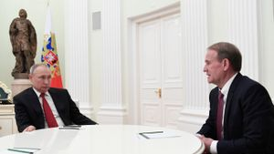 Vladímir Putin y Víktor Medvedchuk en una reunión.