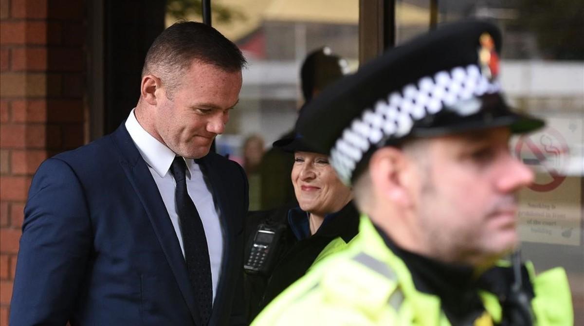 Wayne Rooney, este lunes, a la salida del juzgado de Stockport.