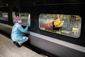 A medical staff looks through the window of a TGV high speed train before its departure to evacuate patients infected with the COVID-19 from Paris region hospitals to Brittany, as the spread of the coronavirus disease continues, in Paris, France April 1, 2020. Picture taken April 1, 2020. Thomas Samson/Pool via REUTERS