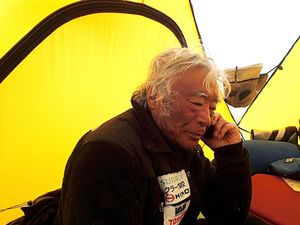 In this Tuesday, May 21, 2013, photo distributed by Miura Dolphins, 80-year-old Japanese extreme skier Yuichiro Miura rests in a camp at 8,000 meters (26,247 feet) during his attempt to scale the summit of Mount Everest. According to his management office, Miura plans to reach the 8,850-meter (29,035-foot) peak on Thursday, May 23 to be the world's oldest person to climb the world's highest peak. His rival, 81-year-old Min Bahadur Sherchan, from Nepal, who nabbed the record just before he could in 2008, was at the base camp preparing for his own attempt on the summit next week. (AP Photo/Miura Dolphins)  MANDATORY CREDIT