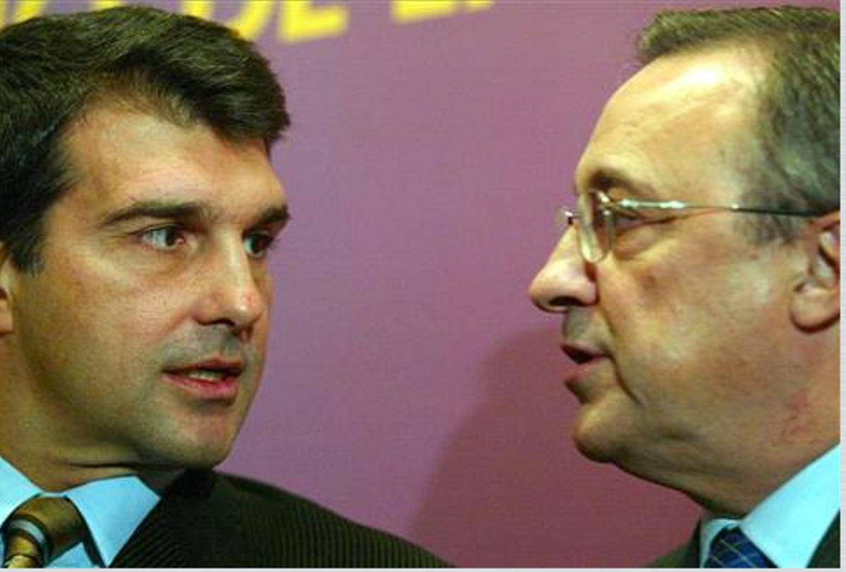 Laporta y Florentino, en un acto en diciembre del 2003.