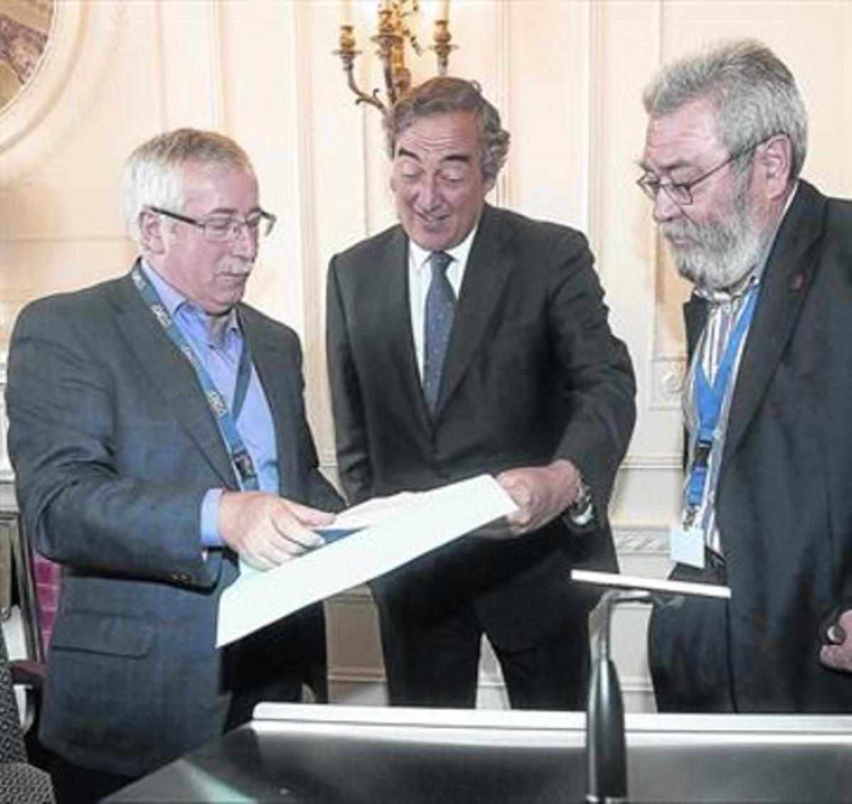 Fernández Toxo, Rosell y Méndez, durante un encuentro en un seminario.