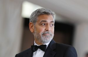 FILE PHOTO: Actor George Clooney arrives at the Metropolitan Museum of Art Costume Institute Gala (Met Gala) to celebrate the opening of Heavenly Bodies: Fashion and the Catholic Imagination in the Manhattan borough of New York, U.S., May 7, 2018.  REUTERS/Carlo Allegri/File Photo