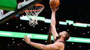 BOSTON, MA - OCTOBER 25: Marc Gasol #33 of the Toronto Raptors drives to the basket in the first half against the Boston Celtics at TD Garden on October 25, 2019 in Boston, Massachusetts. NOTE TO USER: User expressly acknowledges and agrees that, by downloading and or using this photograph, User is consenting to the terms and conditions of the Getty Images License Agreement.   Kathryn Riley/Getty Images/AFP