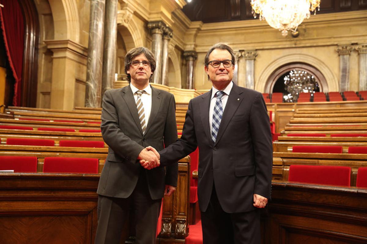 Carles Puigdemont y Artur Mas, al finalizar el debate de investidura del pasado domingo.