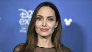 Angelina Jolie attends the  Go Behind the Scenes with the Walt Disney Studios   press line at the 2019 D23 Expo  Saturday  Aug  24  2019  in Anaheim  Calif  (Photo by Richard Shotwell Invision AP)