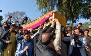 Mourners carry the coffin of female news anchor Malalai Maiwand  who was shot dead by gunmen in Jalalabad on December 10  2020  (Photo by NOORULLAH SHIRZADA   AFP)