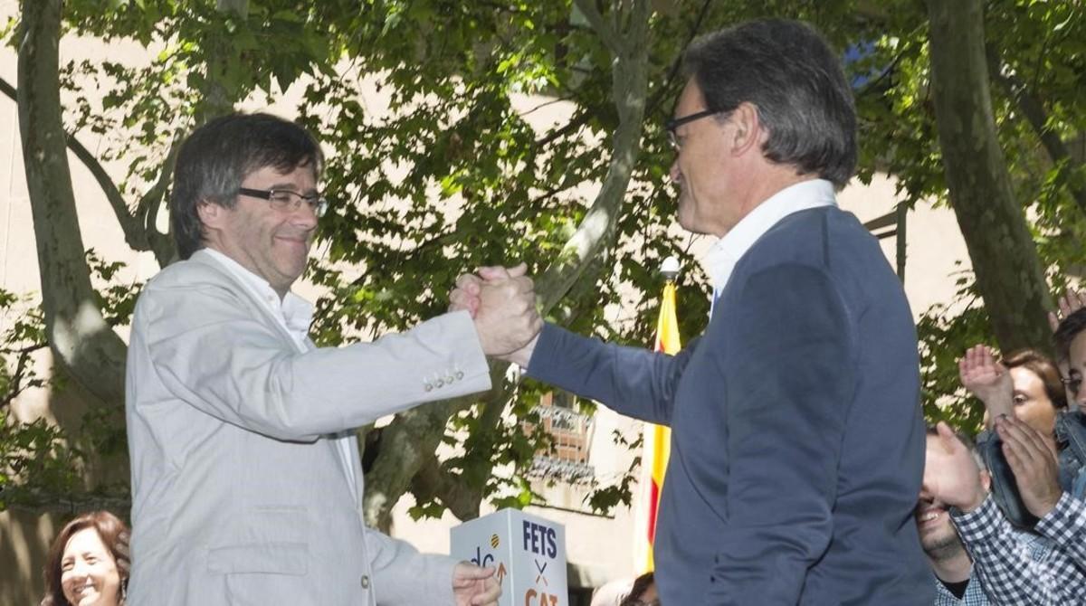 Artur Mas y Carles Puigdemont, en unacto de campaña reciente.