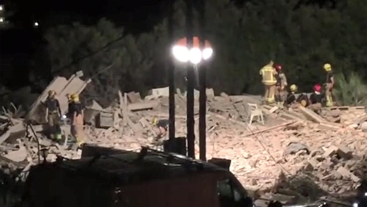 Las ruinas de la casa tras la primera explosión.