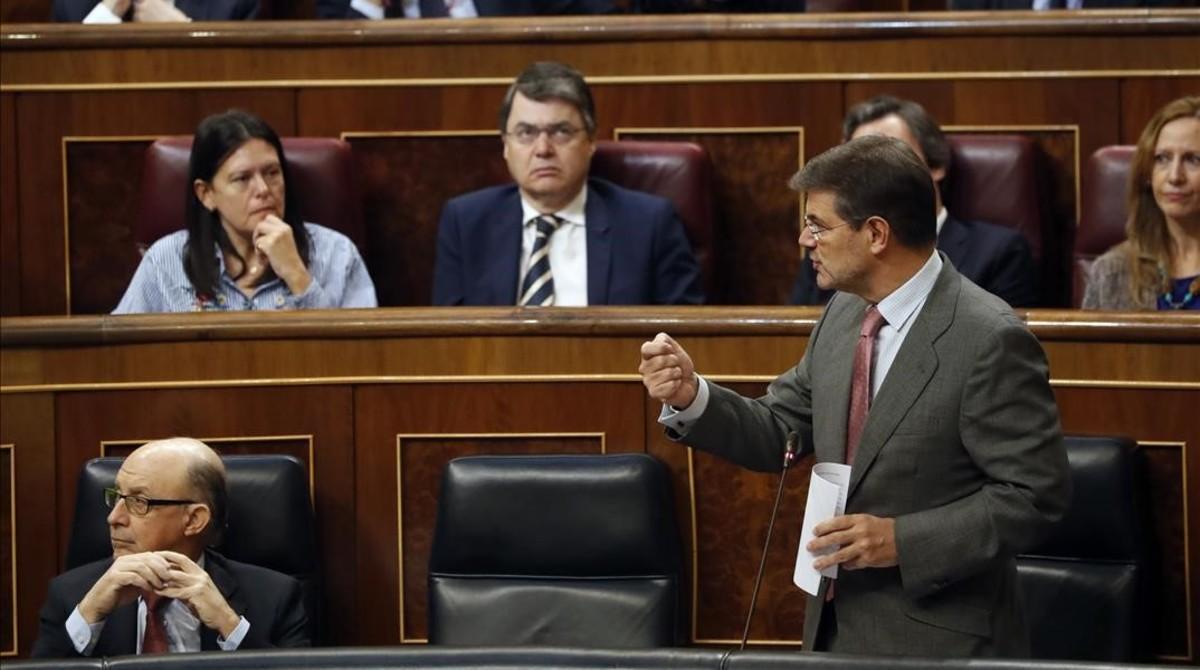 El ministro de Justicia, Rafael Catalá, durante su intervención en la sesión de control el 22 de febrero.