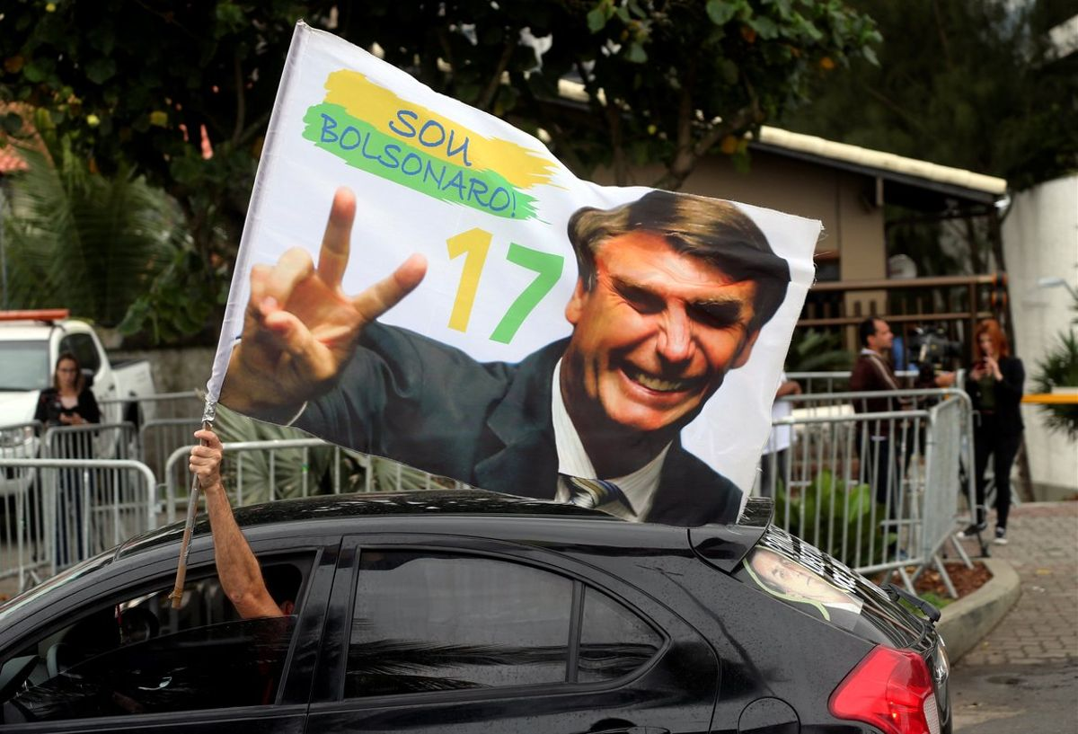 A supporter of Brazil's new president-elect, Jair Bolsonaro, celebrates in front of Bolsonaro's condominium at Barra da Tijuca neighborhood in Rio de Janeiro, Brazil.REUTERS/Sergio Moraes