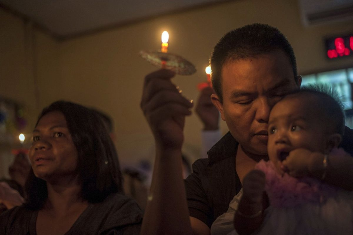 People attend a Christmas service at Rahmat Pentecostal Church in CaritaIndonesiaChristmas celebrations traditionally filled with laughter and uplifting music were replaced by somber prayers for tsunami victims inIndonesiaAP Photo Fauzy Chaniago