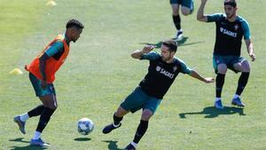 Semedo, en un entrenamiento de la selección portuguesa junto a Moutinho y Guedes.