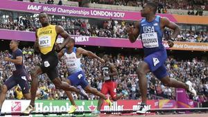 Christian Coleman (derecha, junto a Bolt), cuando fue subcampeón mundial en Londres 2017.