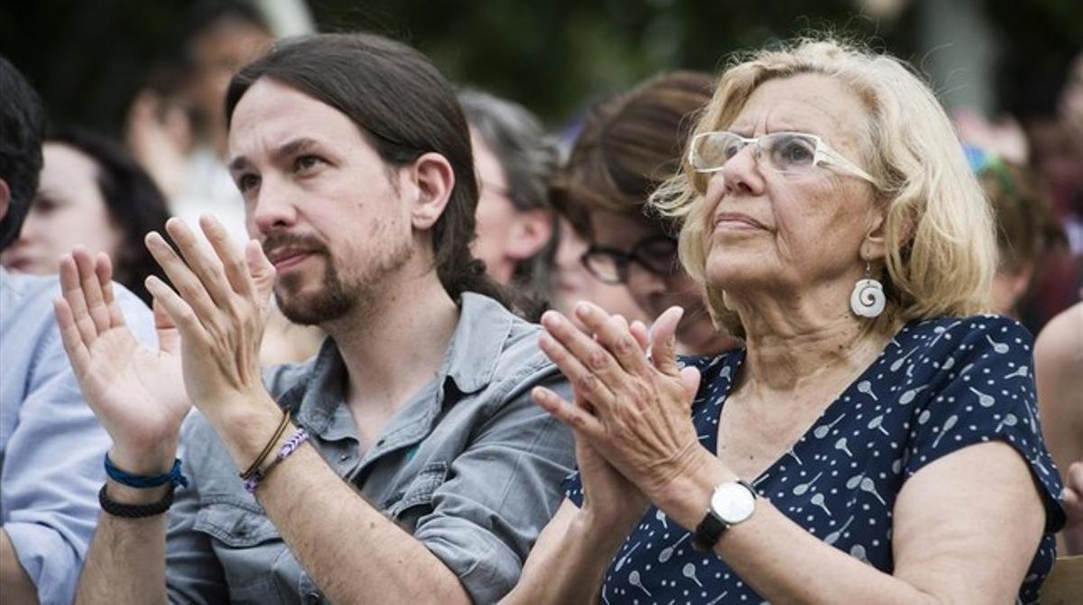 Pablo Iglesias y Manuela Carmena, en un mitin en Madrid.