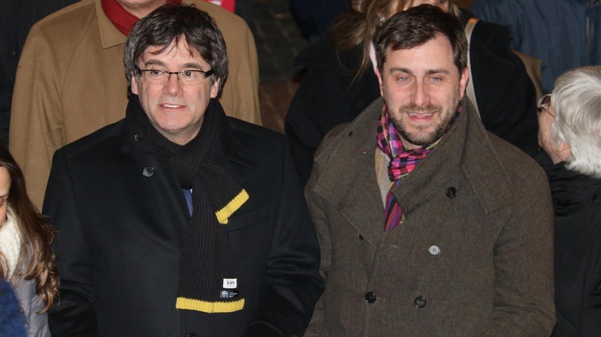 Carles Puigdemont y Toni Comín, en un acto en Lovaina el pasado 6 de febrero.