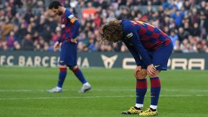Griezman y Messi, tras perder una ocasión de gol ante el Getafe.