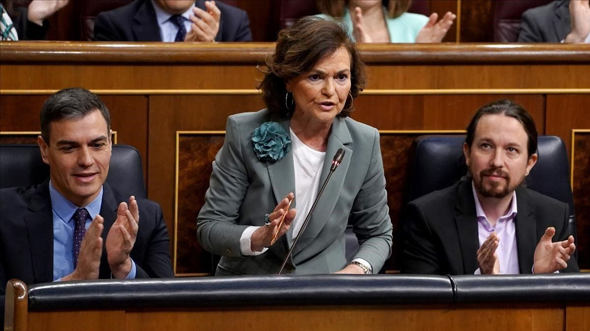 El presidente del Gobierno, Pedro Sánchez, la vicepresidenta Carmen Calvoy el vicepresidente Pablo Iglesias, en el Congreso.
