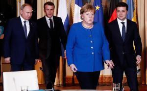 Putin, Merkel, Macron y Zelensky, antes de empezar la reunión en París.