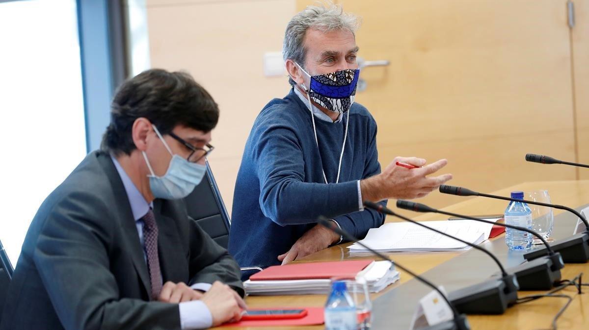 El ministro Illa y Fernando Simón, durante la reunión que han mantenido con los frepresentates de la Comunidad de Madrid.