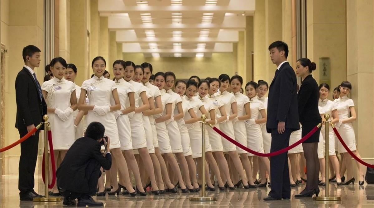 Azafatas posan para las cámaras durante la reunión del G20 este fin de semana en Chengdu, en el sur de China.