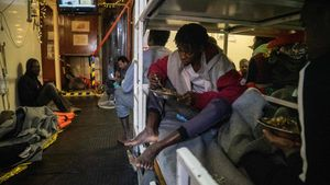 Rescued migrants eat a hot meal onboard the Dutch-flagged rescue vessel Sea Watch  sailing the Mediterranean about 3 nautical miles off Malta s coast  a day after Mediterranea and Sea-Watch launched two boats to deliver supplies  including fresh water  -  Photo by FEDERICO SCOPPA   AFP