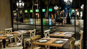 Mesas en el restaurante La Poma, en La Rambla.