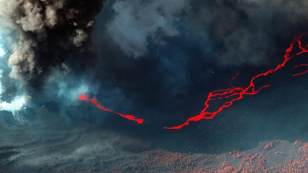 Una imagen de satélite en color infrarrojo muestra lava fluyendo mientras el volcán Cumbre Vieja continúa en erupción en la isla canaria de La Palma, España, 14 de octubre de 2021.