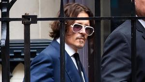 Johnny Depp entra en el Tribunal de Londres para comparecer en el juicio contra el diario 'británico' The Sun'.
