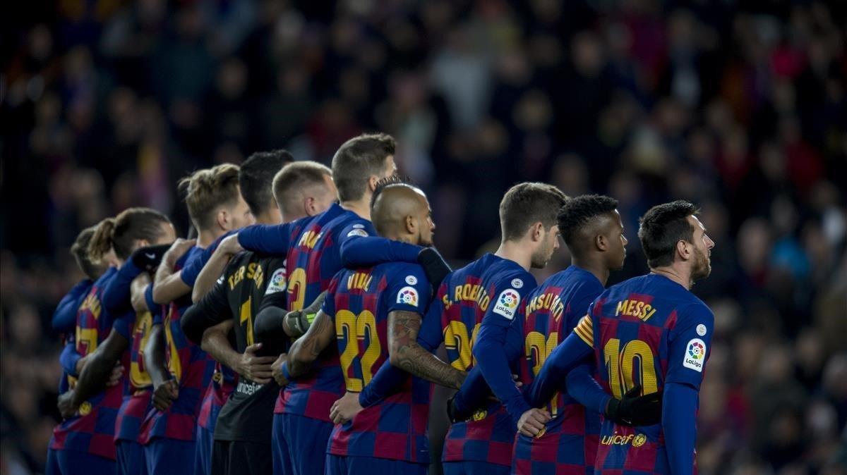Los jugadores del Barça, en el Camp Nou.