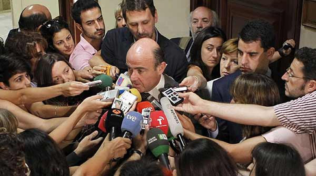 Guindos descarta el rescate de España