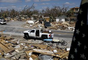 William Johnson helps pack up a friend s belongings as he returns to his damaged home from hurricane Michael in Mexico BeachFla. AP Photo David Goldman