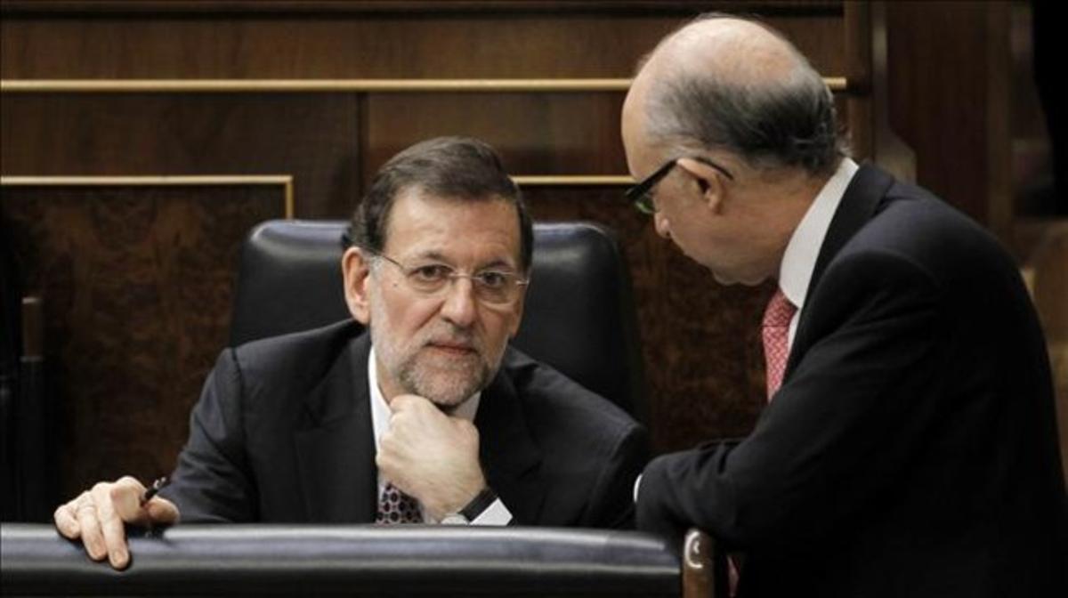 Mariano Rajoy y Cristóbal Montoro, en el Congreso.