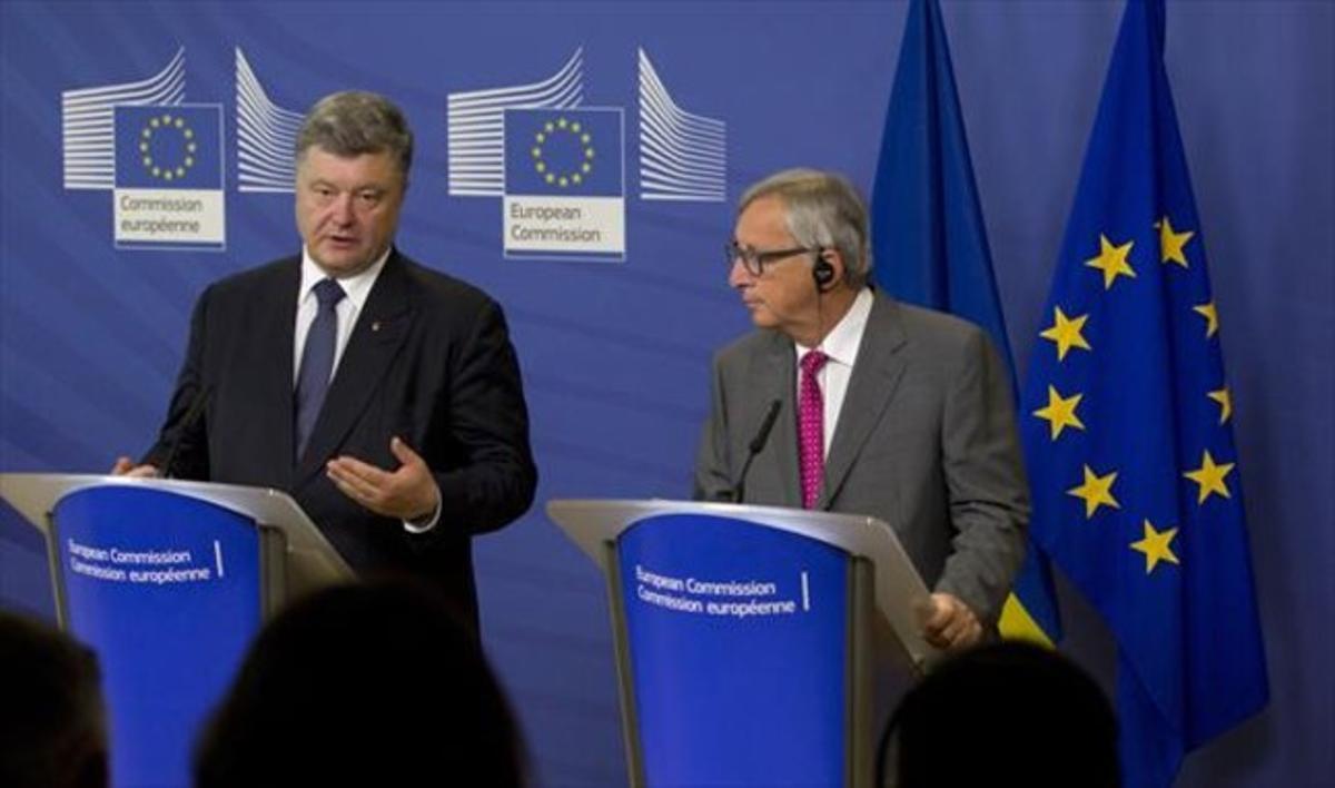 El presidente ucraniano Petró Poroshenko y el de la Comisión, Juncker.