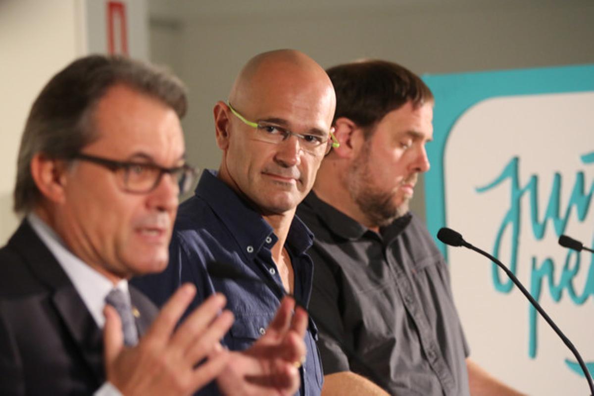 Artur Mas, Raül Romeva y Oriol Junqueras, este lunes, 21 de septiembre, en un acto de Junts pel Sí.