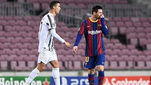 Juventus  Portuguese forward Cristiano Ronaldo (L) walks past Barcelona s Argentinian forward Lionel Messi during the UEFA Champions League group G football match between Barcelona and Juventus at the Camp Nou stadium in Barcelona on December 8  2020  (Photo by Josep LAGO   AFP)